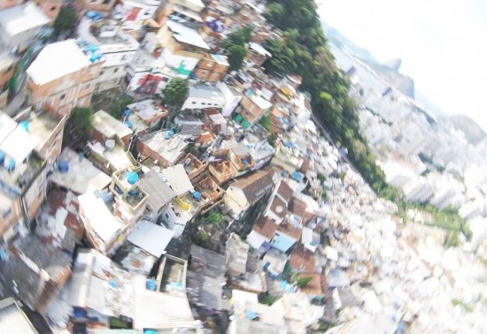 Radially blurred aerial view of favelas in Rio de Janeiro's Santa Marts hill region.