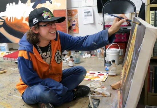 SoVA student painting in studio.