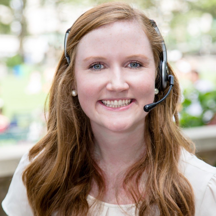 Penn State alumna and events professional Carolyn Quinn wearing headset.