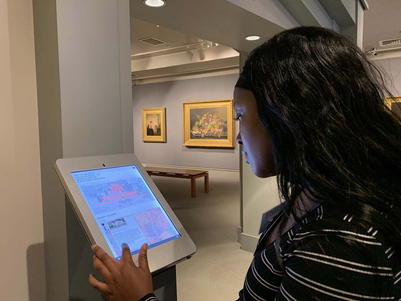 Palmer student ambassador using iPad to view VRC digital project on iPad in Palmer Museum of Art