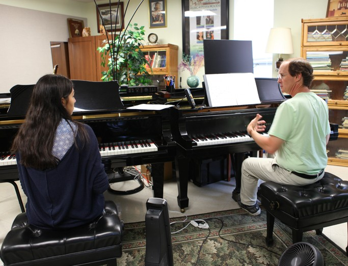 Piano instruction with faculty and student.