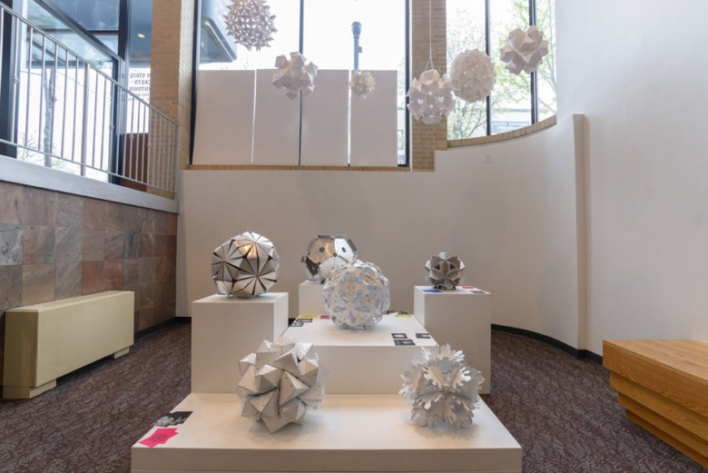 A set of geometric ball sculptures on display in the Woskob's alcove.
