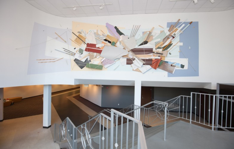 A large mural adorns the Woskob Gallery's wall by the entrance.