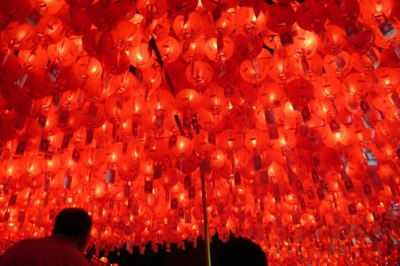 Brilliant red and yellow glow of hundreds of overhead paper lanterns