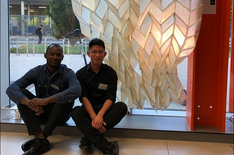"Jimi Demi-Ajayi and Julian Huang in front of their ""Phototropic Origami Structure"" project in London."