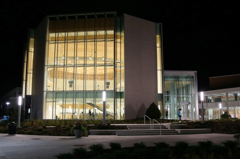 Esber Recital Hall illuminated at night.