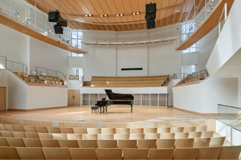 Grand piano on Esber Recital Hall stage, seen from center stage seating.