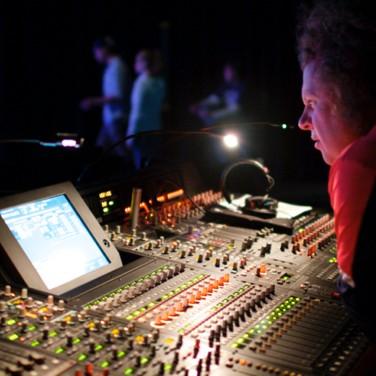 Curtis Craig working at sound board.