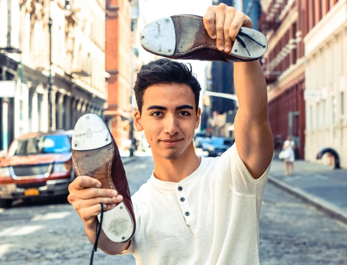 Dario Natarelli holding tap-dance shoes