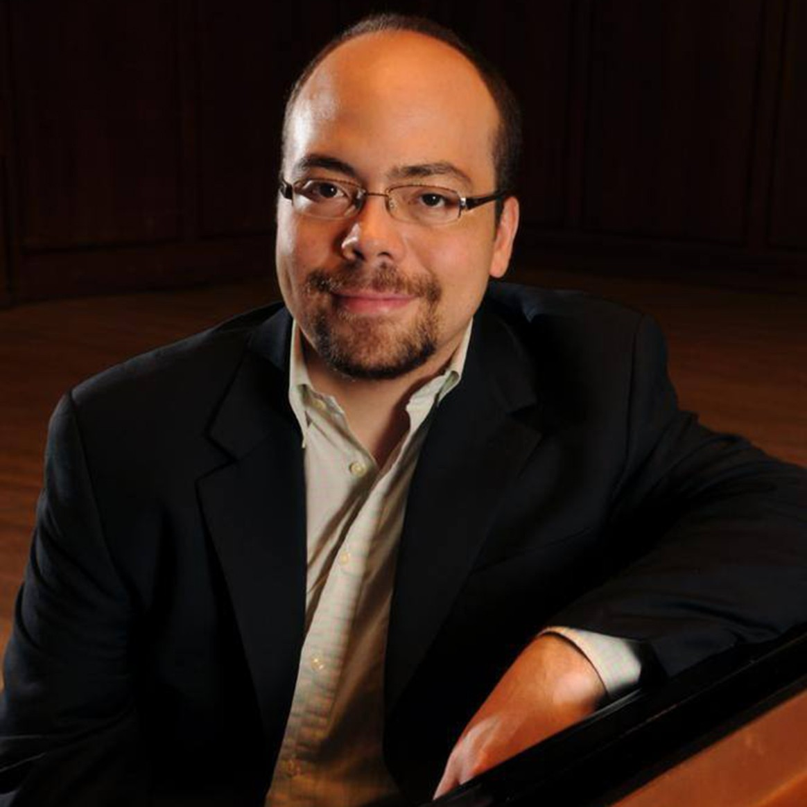 Headshot of Penn State Associate Professor of Piano Christopher Guzman