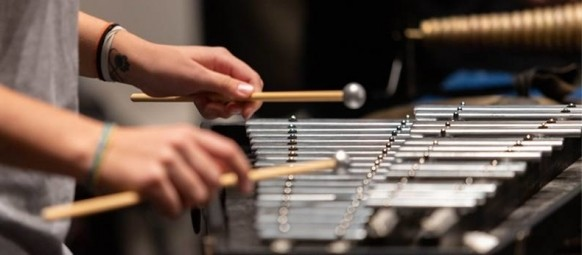 Close up of a music student playing their glockenspiel.