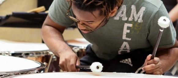 School of Music student tuning his timpani drum before rehearsal.