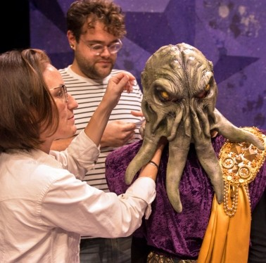 Student getting their headpiece and costume adjusted during a rehearsal break for the play She Kills Monsters.