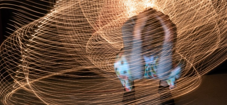 An interactive exhibition at the Woskob gallery of a participant creating unique spatial design with light painting.