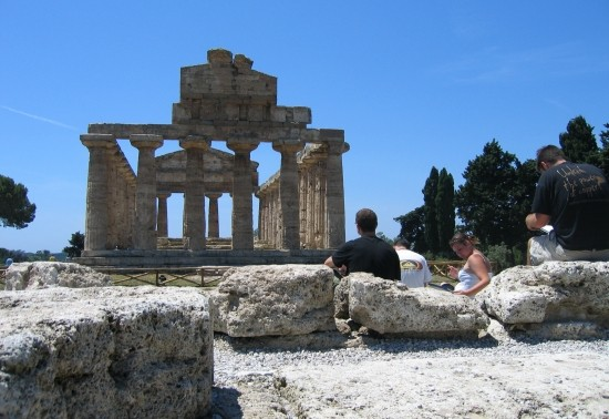 Students sitting at the ruins of Paestum, sketching the architecture.