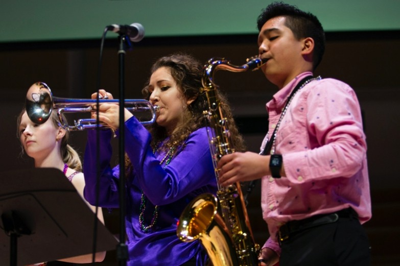 A saxophonist and trumpeter playing in the Mardi Gras Jazz Concert, Spring 2020