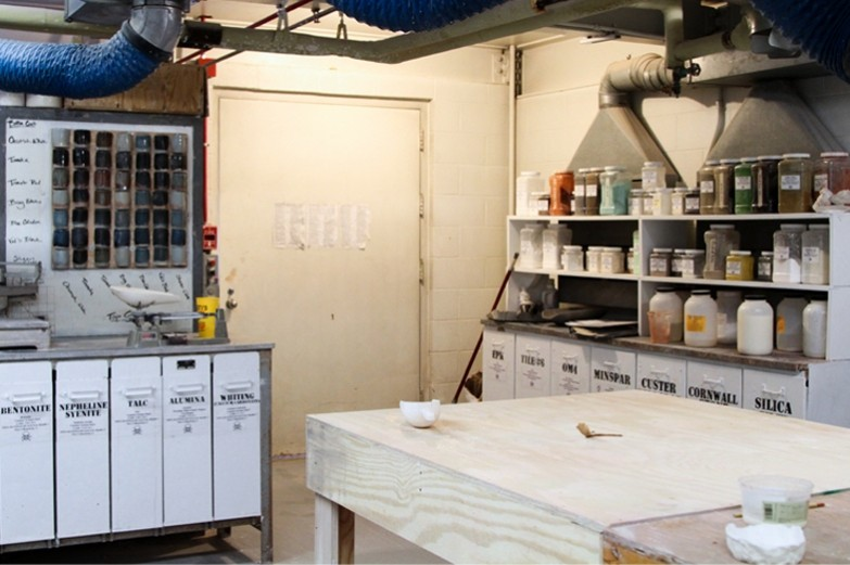 The fully stocked glaze room in the SoVA Ceramics Studio with extensive material inventory.
