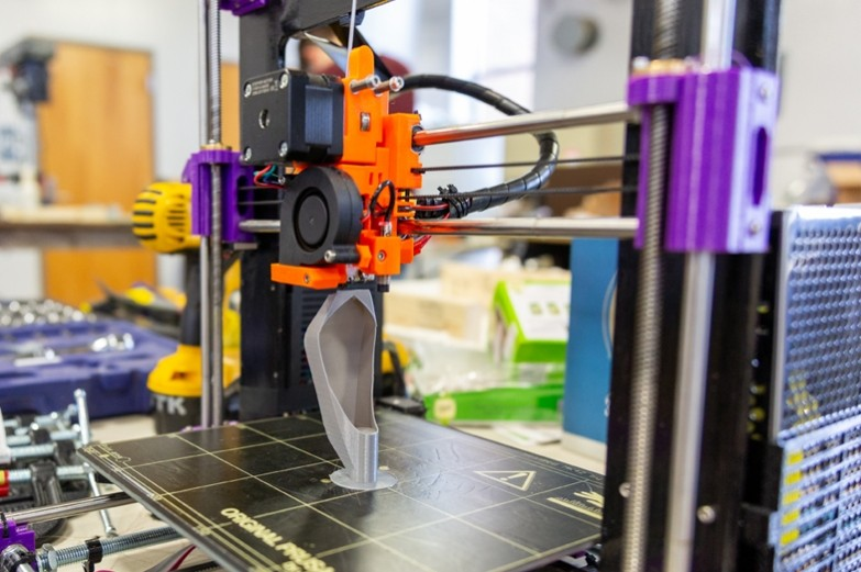 3D printer printing a base leg for an architecture structural wall project.