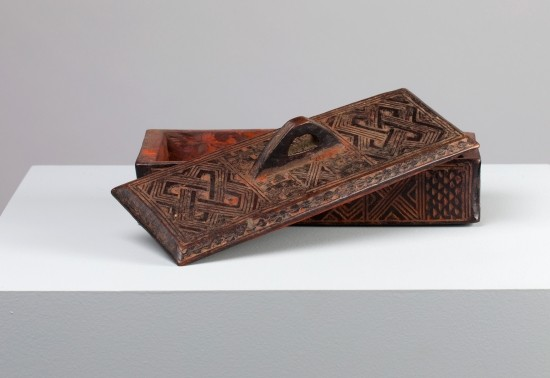 A 20th century decorated wooden box called a Tukula container produced by Kuba carvers from the Democratic Rebublic of the Congo.