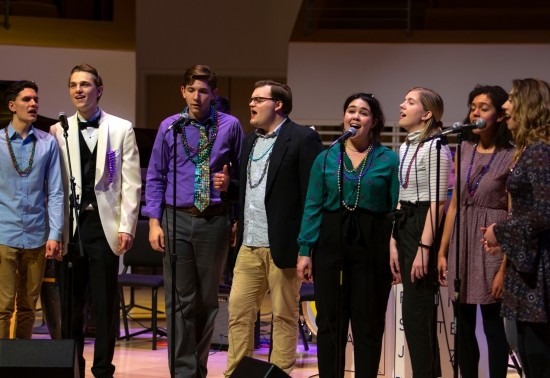 School of Music vocalists performing on stage during the Mardi Gras Jazz Concert at the Recital Hall.