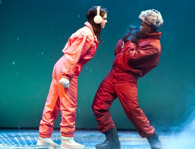 A scene from the play Angels in America. A female and male character are outside in the snow and she is confronting him.