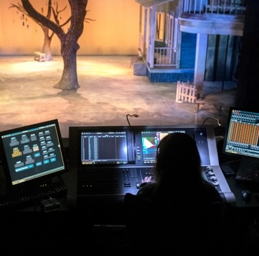 Stage crew student adjusting sound and lighting for the production of To Kill a Mockingbird.