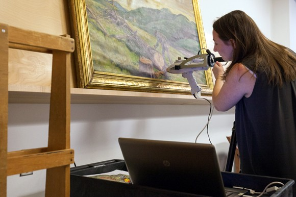 Art History graduate student digitally investigating color on a painting.