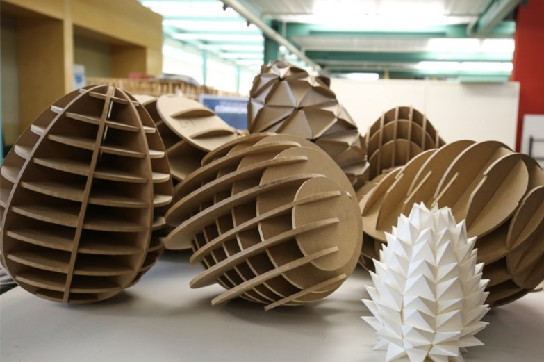 First year architecture student cylindrical 3d models made out of medium density fiberboard and paper.