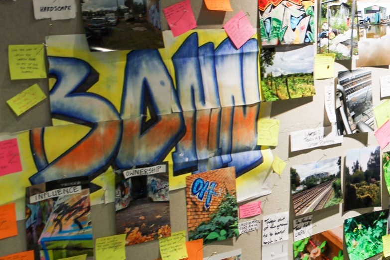 Mood board of various colorful street art and landscape materials in a landscape architecture workshop.