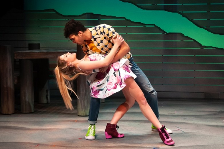 A scene from the musical A Lucky Boy. A female and male character is dancing together and he dips her looking intently into her eyes.