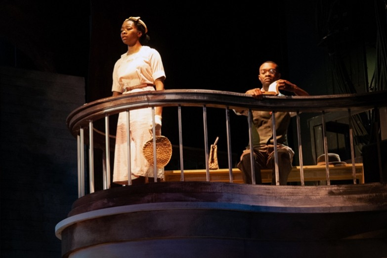 A scene from the production of To Kill A Mockingbird where a female and male actor are on a balcony. Performed in the Playhouse Theatre at the University Park campus.