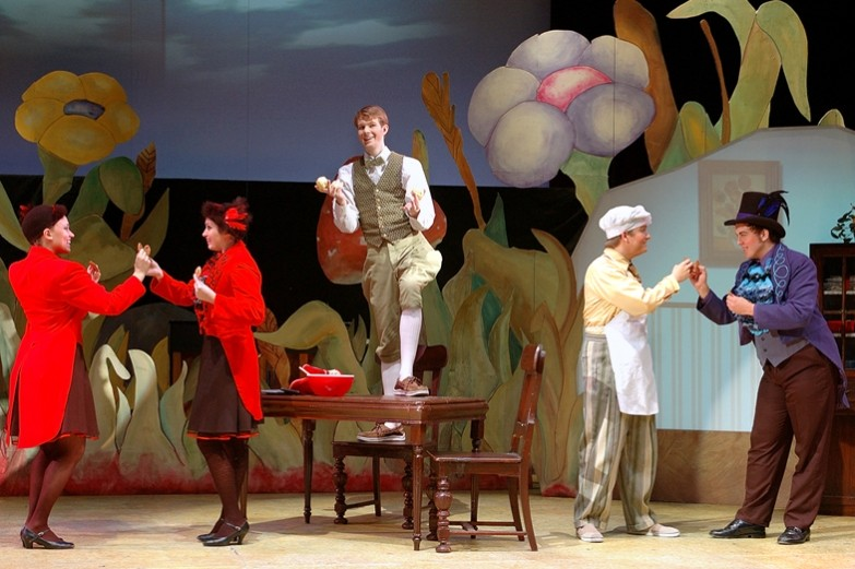 A scene from the production of A Year With Frog and Toad where actors in bright-colored costumes are performing a musical number. Performed in the Playhouse Theatre at the University Park campus.