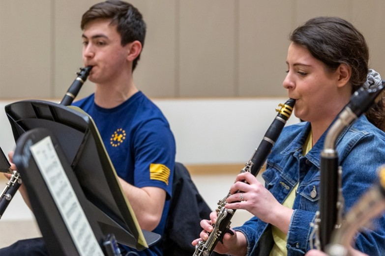 School of Music students playing their clarinets during a music rehearsal.