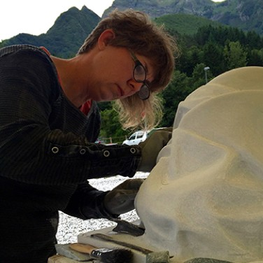 Cristin Millet working on marble sculpture in Italy