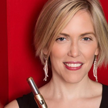 Close-up portrait of Naomi Seidman with flute against red background.