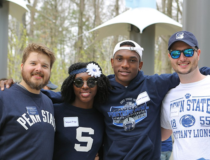 College of Arts and Architecture alumni and friends gather together for a picture during a tailgate party on blue and white weekend.