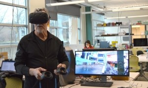 Photo of a Stuckeman faculty member demonstrating augmented reality equipment in one of Stuckeman's workshops.