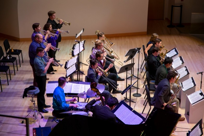 The Penn State Jazz band performs their instruments during the Mardi Gras concert.