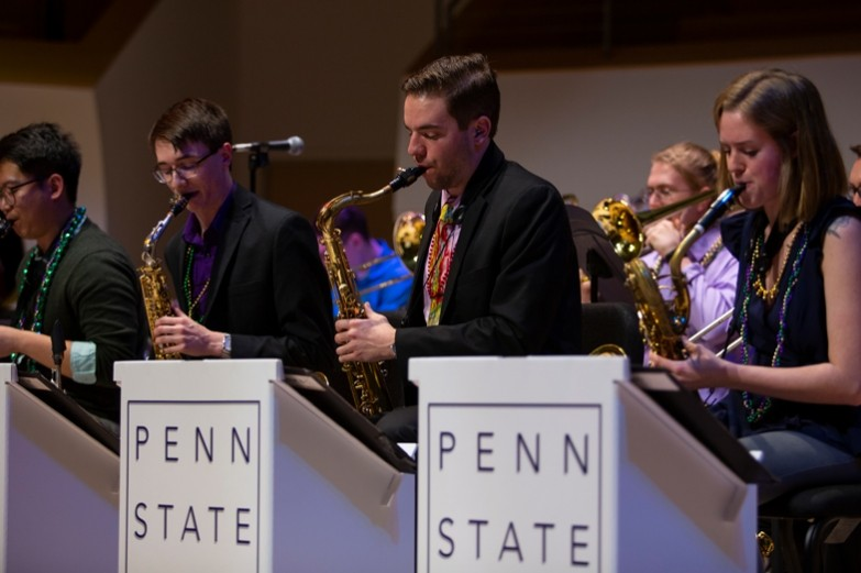 A group of the Penn State Jazz band perform their saxaphones during the Mardi Gras concert.
