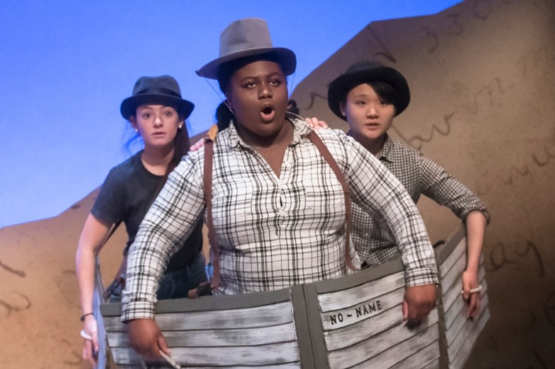 Three student performers in boats sing a song during the theatre production of Men on Boats.
