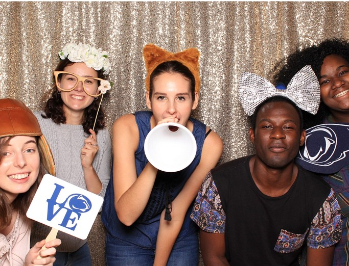 Five students posing in a photo booth at a start-of-semester welcome back event in the Stuckeman School.
