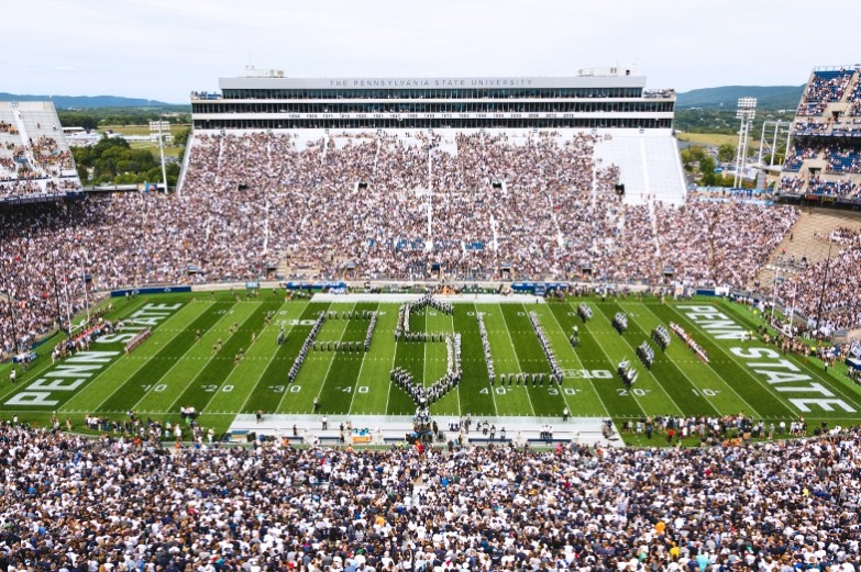 The blue band performing during halftime of a Penn State football game.