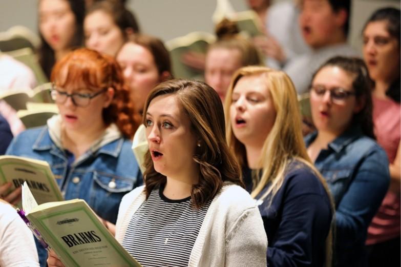 A group of choral singers performing Brahms