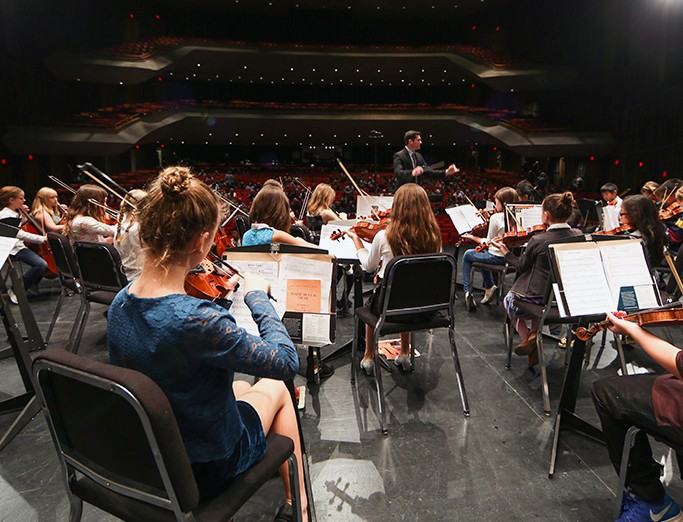 Elementary School Students and Penn State School of Music students participate in the tenth anniversary Partners in Music concert.