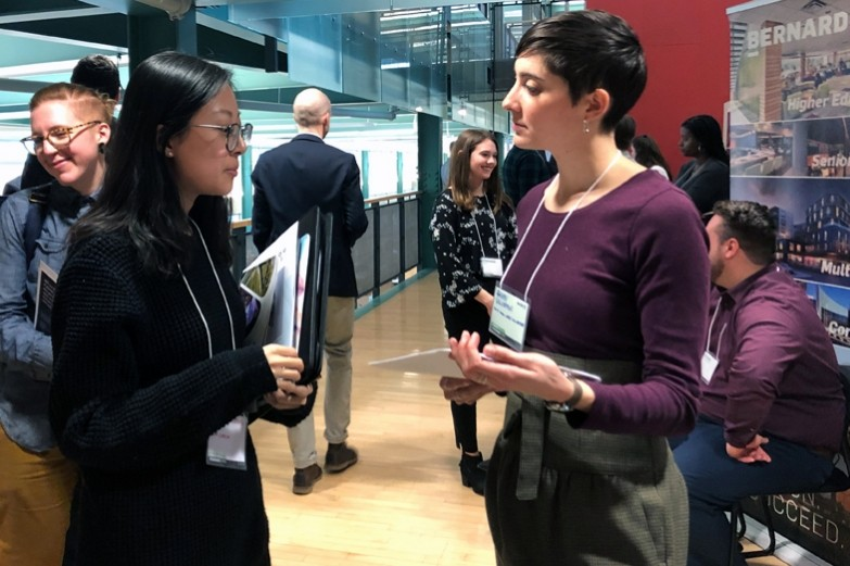 Students and professional firm representatives gathered and talking during Career Day, held in the glass, wood, and steel mezzanine area of the Stuckeman School.