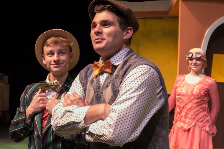 Three actors, two i nthe foregraound and one looking on from the background, in a performance of Frog and Toad.