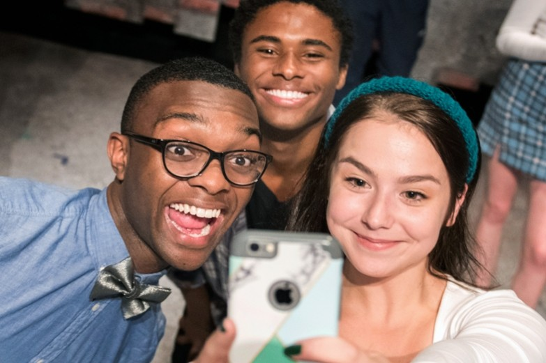 Three student actors taking a selfie during practice for the School of Theatre's production of 'Hooded'