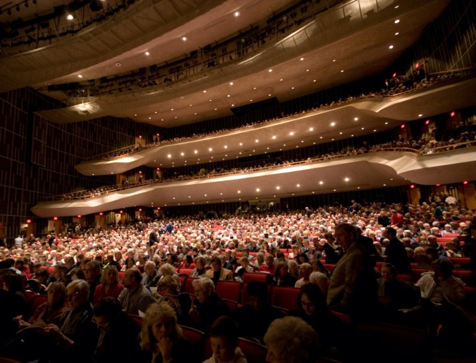 A full-house crowd spread across all three levels of the Center for Performing Arts' Eisenhower Auditorium