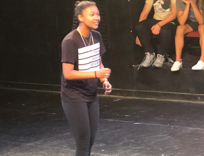 A musical theatre summer camp student performing in Penn State's Pavilion Theatre.
