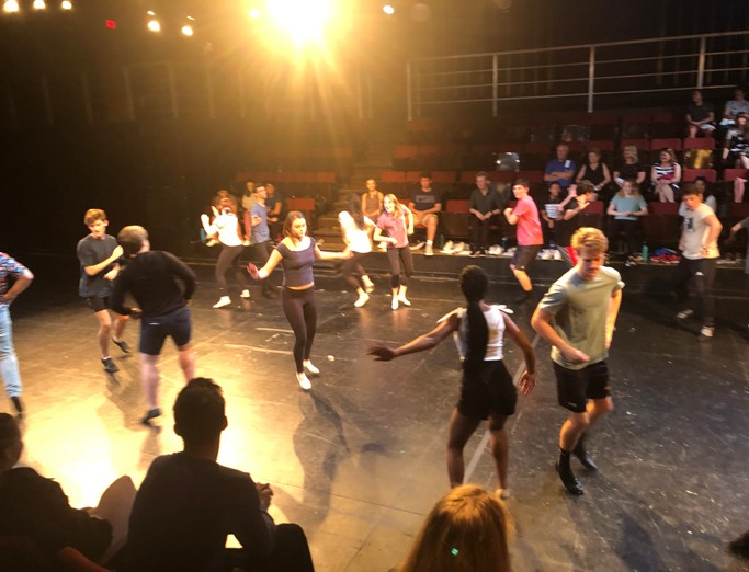 Musical theatre summer camp students dancing in Penn State's Pavilion Theatre.